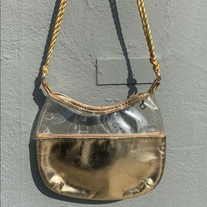 Vintage mod gold and clear plastic purse